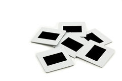 Pile of slides with frames on llightbox. Royalty Free Stock Photography