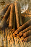 Pile of small cigar on old wooden table overlap. Stock Photography