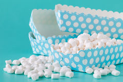 Pile of small colored puffy marshmallows  on aquamarine. Background close up Stock Photos