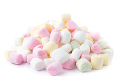 A pile of small colored puffy marshmallows isolated on white bac Stock Photos