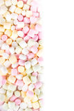 A pile of small colored puffy marshmallows may use as background Royalty Free Stock Photos