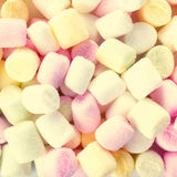 A pile of small colored puffy marshmallows may use as background Stock Photos