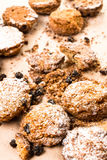 Pile of small cookies on brown paper parchament  background. Pile of small cookies on brown paper parchament Royalty Free Stock Photo