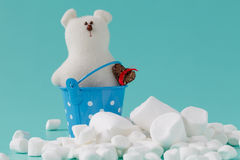 Pile of small puffy marshmallows on aquamarine background close Stock Photography