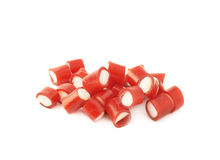 Pile of small red candy sweets isolated Royalty Free Stock Images