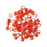 Pile of small red candy sweets isolated Stock Photo
