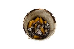 Pile of smoked cigarettes in an ashtray isolated on white Stock Photo