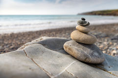 Pile of smooth stones on the beach Stock Images