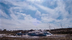 Pile of snow melts in the sun. Time Lapse Royalty Free Stock Photo
