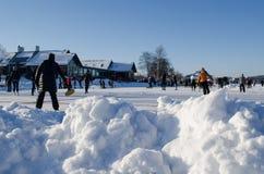 Pile snow people skate play eisstock active Stock Photos