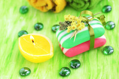 Pile soap. Striped soap against the green background the candle Stock Photography
