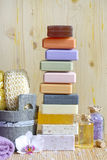 Pile of soaps with cosmetics for spa and body care Stock Photos
