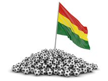 Pile of Soccer footballs and Bolivian flag. Image with clipping path Royalty Free Stock Photography