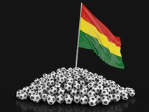 Pile of Soccer footballs and Bolivian flag. Image with clipping path Royalty Free Stock Photo