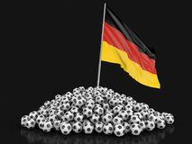 Pile of Soccer footballs and German flag Royalty Free Stock Photography