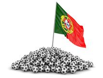 Pile of Soccer footballs and Portuguese flag Stock Photo