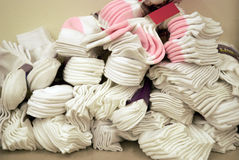 Pile of socks. A pile of brand white socks on a table Royalty Free Stock Photography