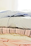 Pile of soft-coloured clothes. A fashion inspired still-life Stock Photo