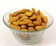 Pile of some almonds on white background. Pile of some fresh dry brown almonds on white background. useful for hair advertisement Royalty Free Stock Images