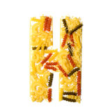 Pile of spaghetti forming a letter H Royalty Free Stock Photos