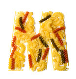 Pile of spaghetti forming a letter M Stock Images
