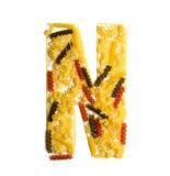 Pile of spaghetti forming a letter N Stock Image