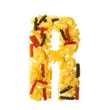 Pile of spaghetti forming a letter R Stock Photos
