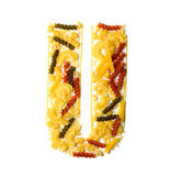 Pile of spaghetti forming a letter U Stock Images