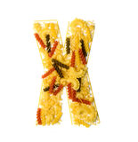 Pile of spaghetti forming a letter X Royalty Free Stock Photos