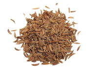 Pile spice cumin in grain clipping path Stock Image