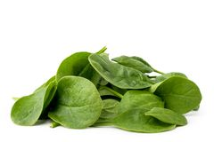 Pile of spinach leaves isolated on a white. Pile of spinach leaves isolated on a white background royalty free stock image