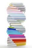 Pile spiralée de livres colorés par arc-en-ciel Photos stock