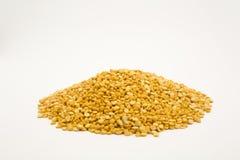 Split yellow peas. Pile of split yellow peas. Isolated on white background stock image