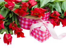 Pile of spring tulips with heart  gift box Stock Photography