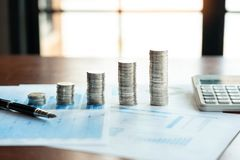 Pile stack of coins saving money and planning financial, accounting  or investment concept royalty free stock images