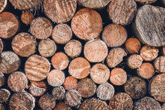 Pile or stack of natural fire wood logs texture background. Royalty Free Stock Photography