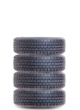 Pile stack or set of four car auto tires Royalty Free Stock Photos