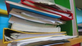 A pile of stacked books and folders royalty free stock images