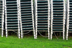 Pile of stacked chairs. Outdoors Royalty Free Stock Photo