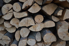 Pile of stacked firewood in rural garden ready for winter. Preparation for the winter. Wooden log abstract background. Dry chopped Stock Photos