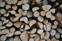 Pile of stacked firewood in rural garden ready for winter. Preparation for the winter. Wooden log abstract background. Dry chopped Stock Images