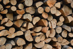 Pile of stacked firewood in rural garden ready for winter. Preparation for the winter. Wooden log abstract background Stock Photos