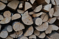 Pile of stacked firewood in rural garden ready for winter. Preparation for the winter. Wooden log abstract background Royalty Free Stock Photos
