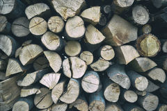 Pile of stacked firewood in rural garden ready for winter. Preparation for the winter. Wooden log abstract background Stock Photography