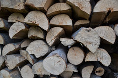 Pile of stacked firewood in rural garden ready for winter. Preparation for the winter. Wooden log abstract background Stock Image