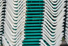 Pile of stacked green sunbeds summer season beach lounge background pattern. A pile of stacked green sunbeds summer season beach lounge background pattern royalty free stock photos