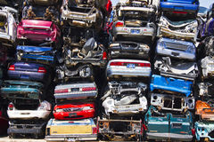 A Pile of Stacked Junk Cars. Discarded Junk Cars Piled Up After Crushing stock photo