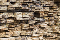 Pile of stacked rough cut lumber Stock Photo