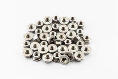 Pile of Stainless Steel Hex Flange Nuts Stock Images