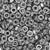 Pile of stainless steel nuts Royalty Free Stock Photo